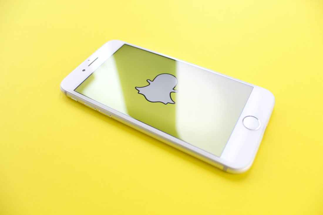snapchat on yellow surface